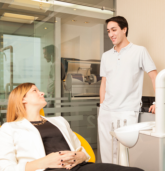 one of our dentist with a patient in its initial consultation for smile design