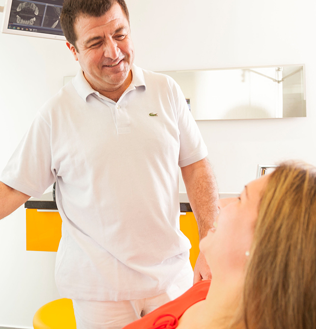 dentist showing a patient her dental scan